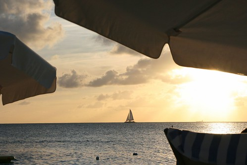 Resort sunset sailboat