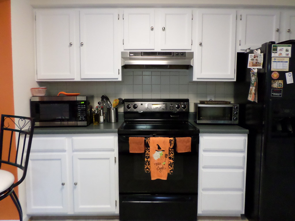 Halloween decor in black, white, and gray kitchen