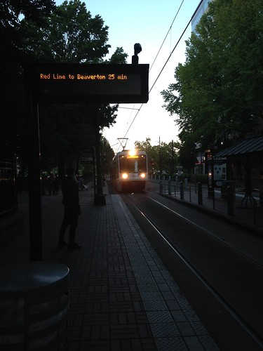 An eastbound Airport train arrives at Lloyd Center