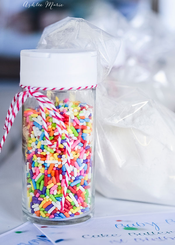 container of sprinkles and a bag of cake mix make the perfect favors