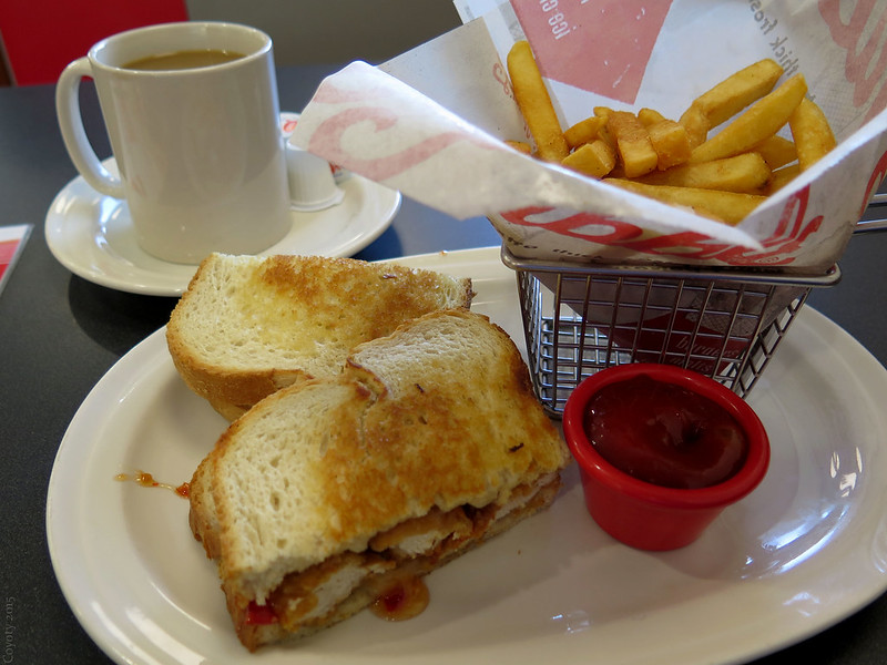 Sweet Red Chili Chicken Supermelt sandwich with fries and coffee