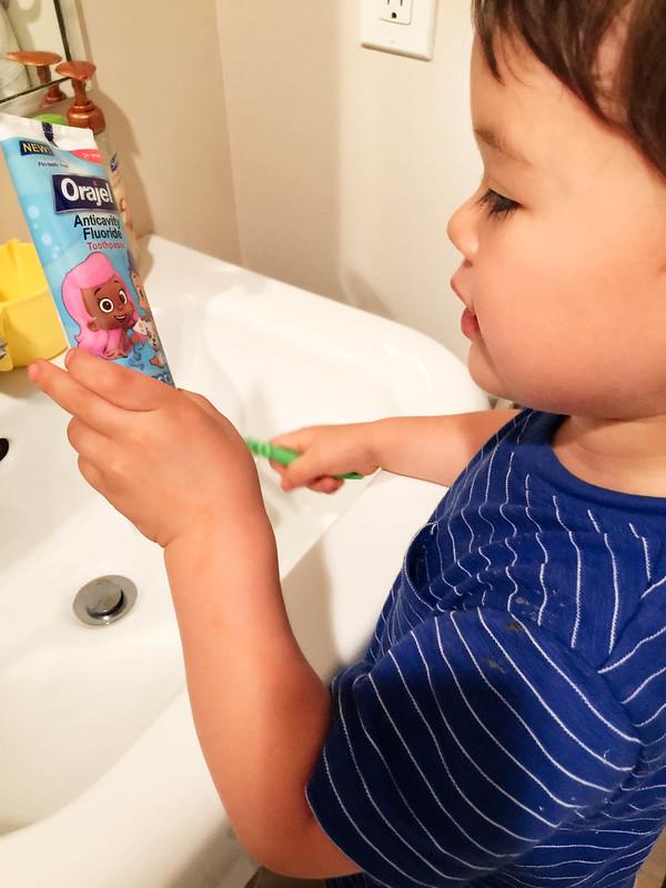 cute & little blog | celebrating #smilestones | toddler toothbrushing