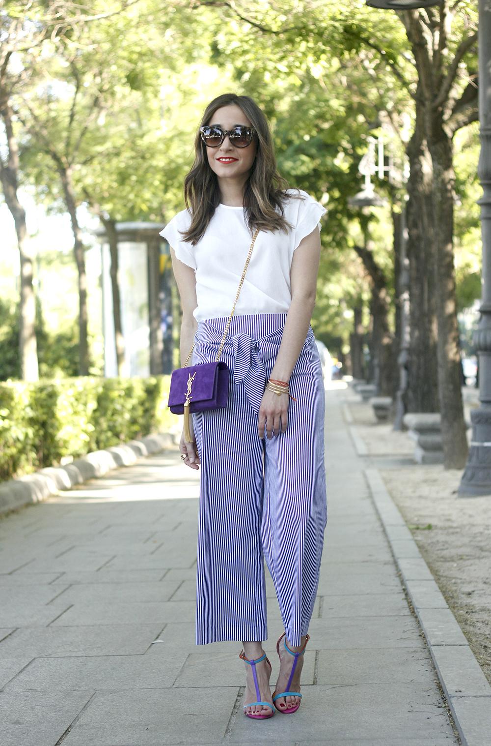 striped pants with bow white shirt carolina herrera sandasl saint laurent bag accessories summer outfit01