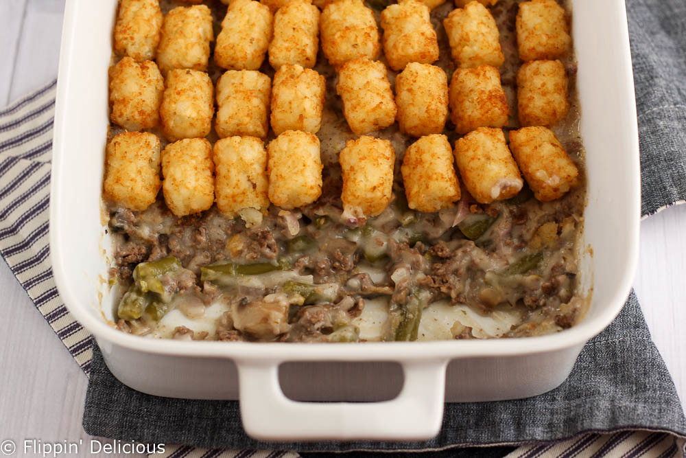 This gluten-free tater-tot casserole is comfort food at its best! Easy, creamy filling filled topped with golden tater-tots.