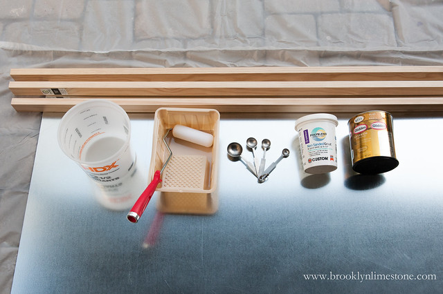 Supplies for Outdoor Chalkboard metal sheet, wood for frame, paint roller and pan, measuring spoons, unsanded grout, paint and mixing container