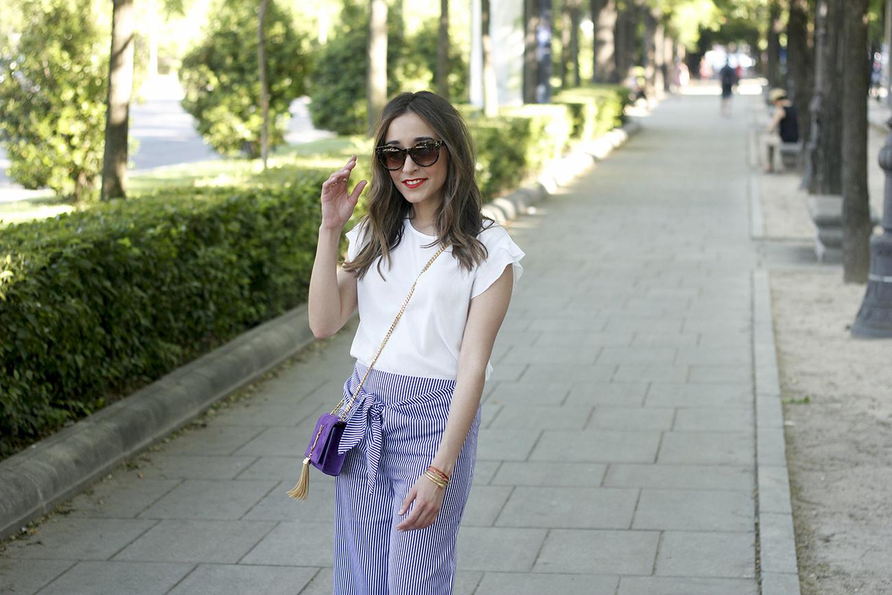 striped pants with bow white shirt carolina herrera sandasl saint laurent bag accessories summer outfit12