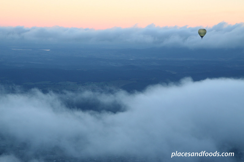 yarra valley hot air ballon on top of clouds