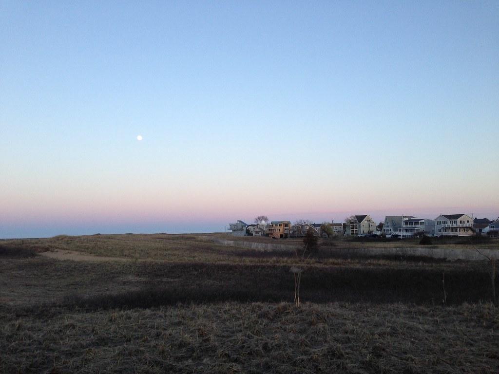 Moon over dunes