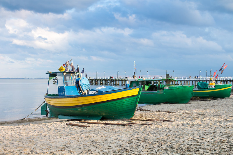 Orłowo Beach & fishing boats in sunlight