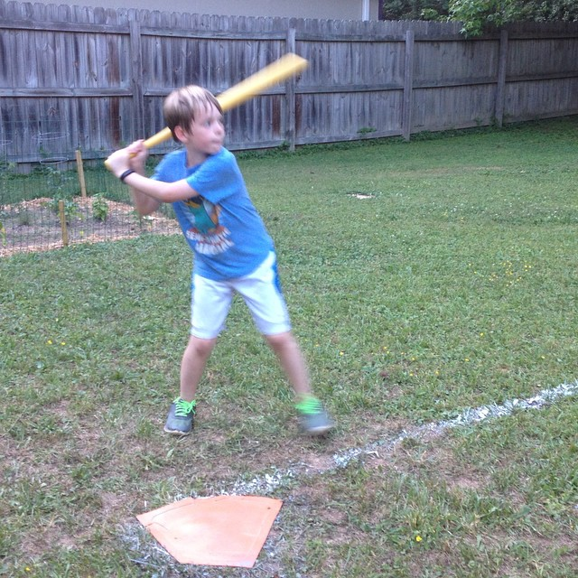 Birthday boy locked in, awaiting a pitch from Dad.