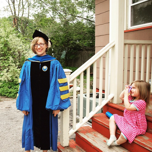 Taking a photo of mama in regalia (finally got commencement-day photos off the DSLR)
