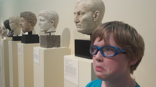 One of these Roman heads is not like the other