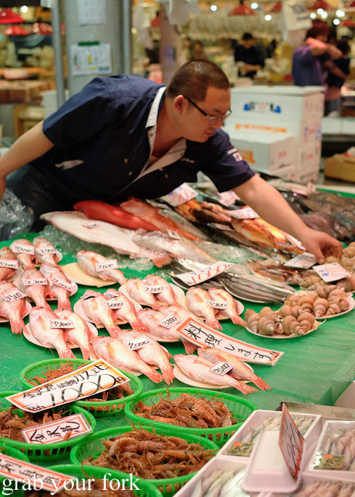 Fishmonger at Omicho Market, Kanazawa, Japan