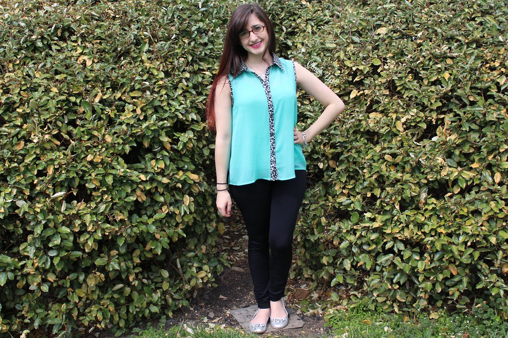 Mint and leopard print top with black leggings.