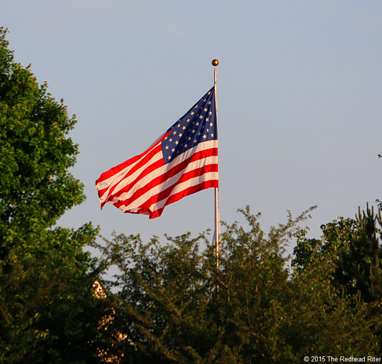 US flag blowing Memorial Day And The Flag Reminds Us Of Our Freedom