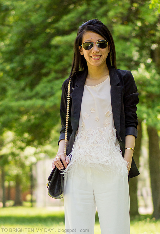black blazer, feathered top, white trousers