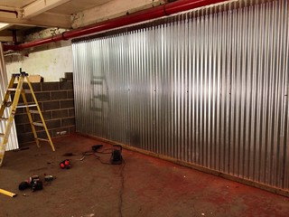 The back wall of the brewery bar area, it was a damp wall that paint didn't want to stick to but now it's funky galvanised steel :-)