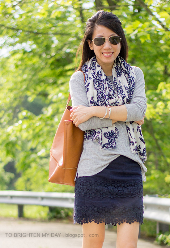 printed scarf, gray tee, navy lace skirt, cognac brown tote