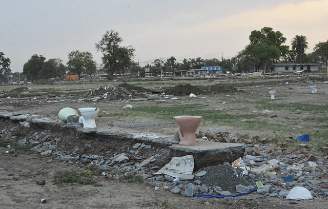 The broken toilets on the Ujjain-Badnagar agricultural land. The makeshift tents were built on this land for religious organisations during Simhastha.