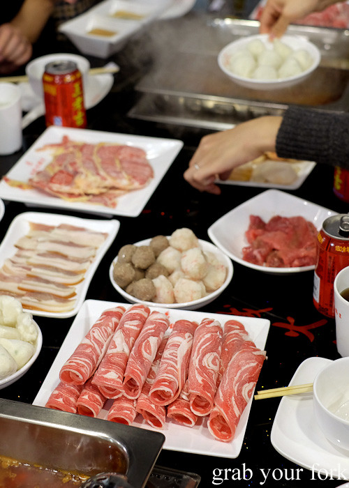 Smoked pork, wagyu slices, special beef, fish balls, beef balls and lamb slices at Shancheng Hotpot King, Sydney