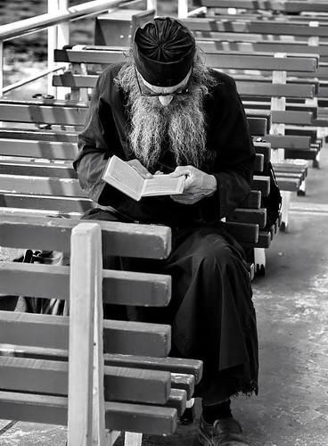 a monk reading a book