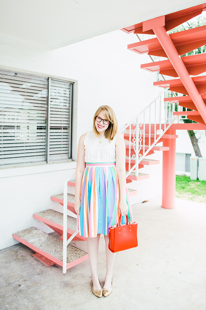 colorful ModCloth skirt, red Ann Taylor crossbody bag, and gold Kate Spade flats