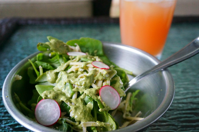 A small salad of greens, radish, snow peas, white cheddar, and of course cilantro sauce.