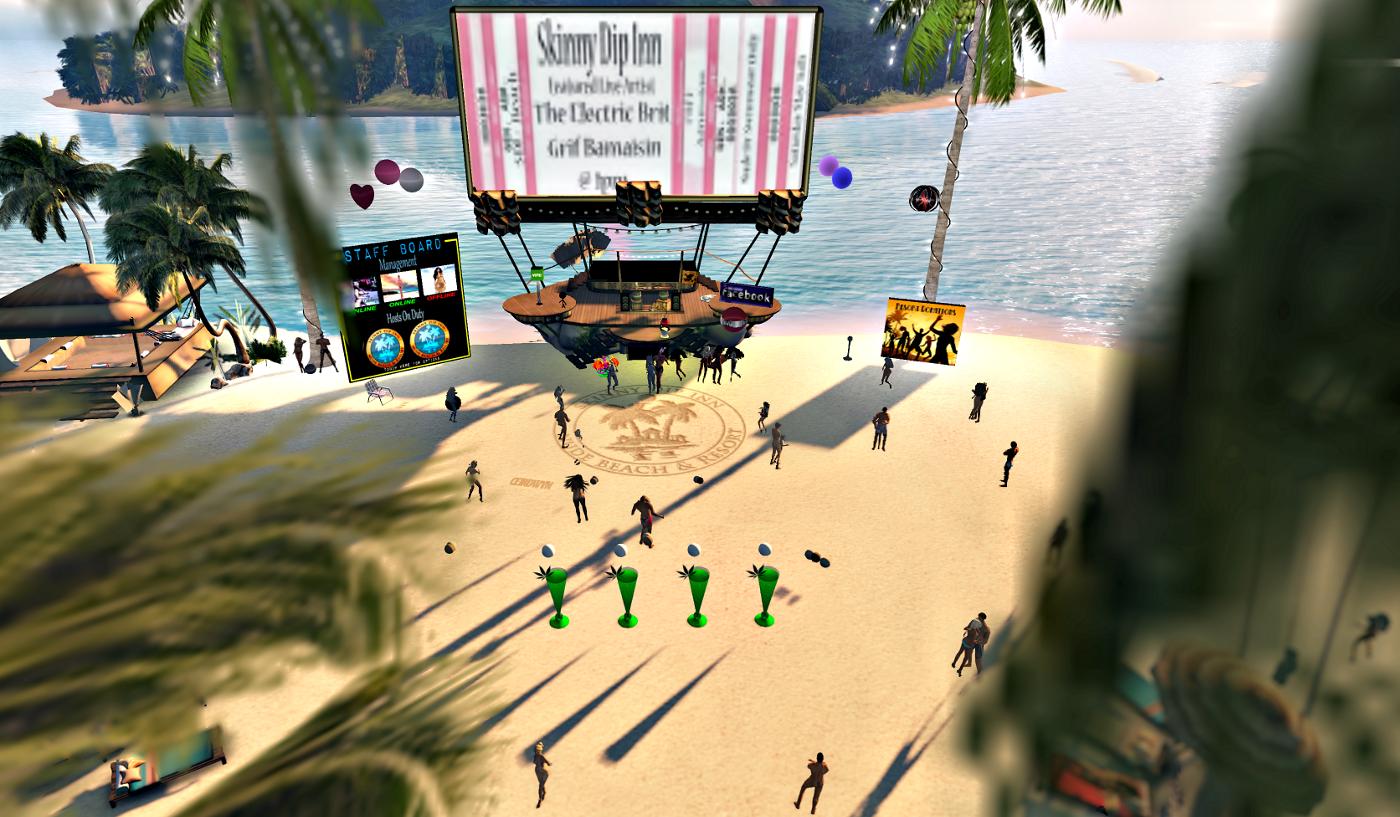 People dancing at the beach, at Skinny Dipp In