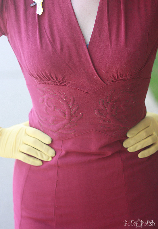 Embroidery detail on a raspberry rayon crepe 1940s dress