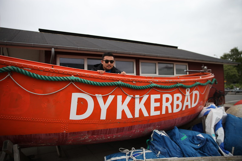 Jeff hiding in a bright orange boat