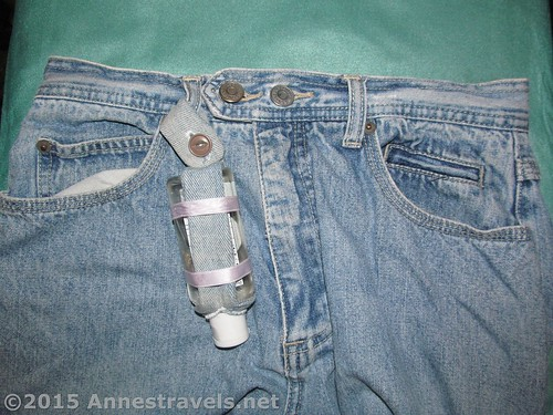 Hand sanitizer bottle holder attached to the belt loop of some (not holey) jeans!