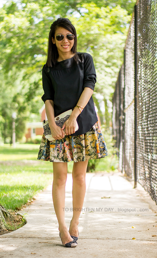black faux leather top, wildflower floral dress as skirt, lace patterned clutch, bow ballerina flats