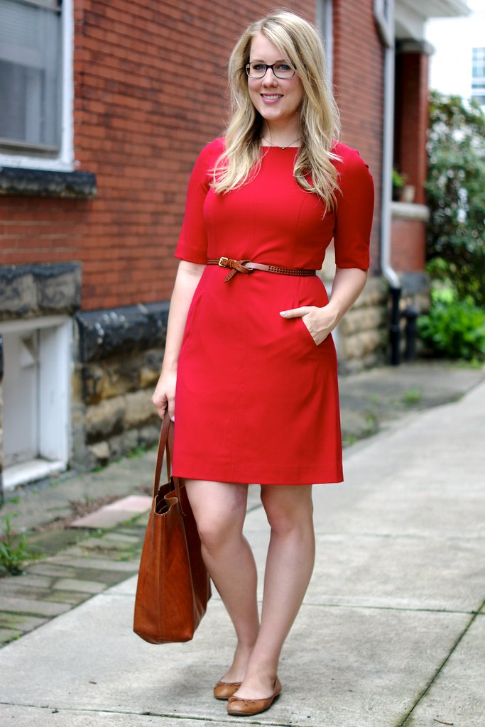 red sheath dress with cognac accessories