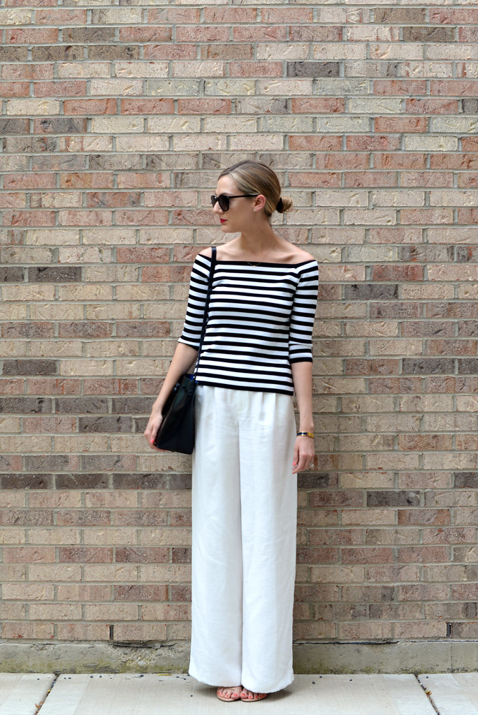 off the shoulder stripe top, chelsea28 white pants, monsieur gavriel bag, saint laurent preppy round sunglasses, stuart weitzman nudistsong