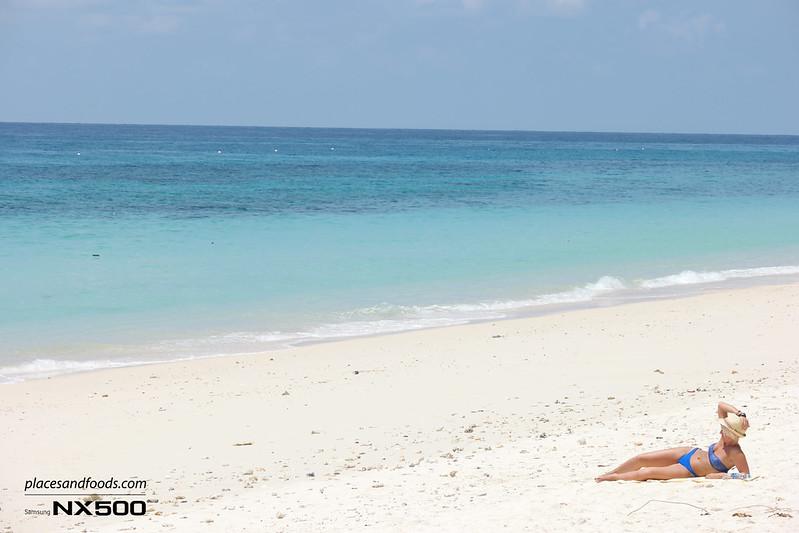 maiton island sunbathing