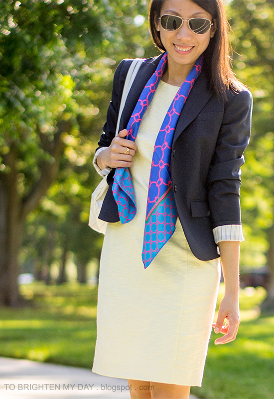navy blazer, yellow sheath dress, blue chain scarf