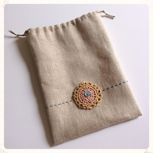 "Heading into my Etsy shop soon: linen ""what-not"" bag, perfect for knitting or crochet notions, keys and phone, what-not. Hand embroidered. Crochet motif made with Habu Cotton Gima. Cotton drawstring. Vintage button. 5.5 inches wide by 7 inches tall. #bonn"