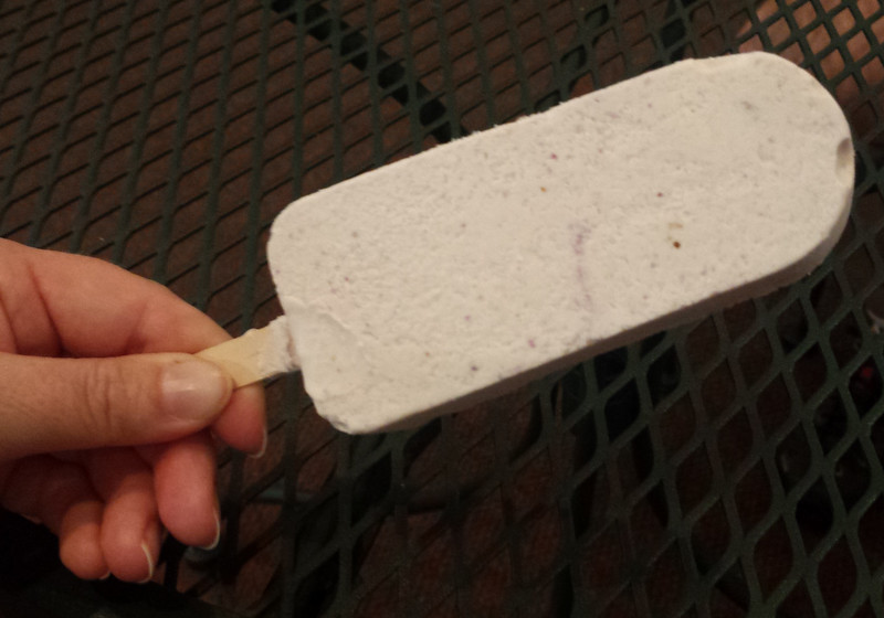 faintly purple ice cream on a stick