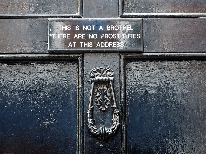 Sign on a door in Soho