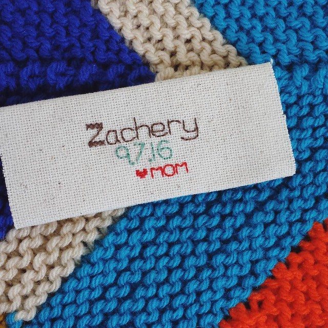 I stitched up a tag for the birthday blanket, I'm planning on doing these for all future blankets I make for the kids! #knittersofinstagram #birthdayblanket #craftastherapy #makersgonnamake #ourmakerlife