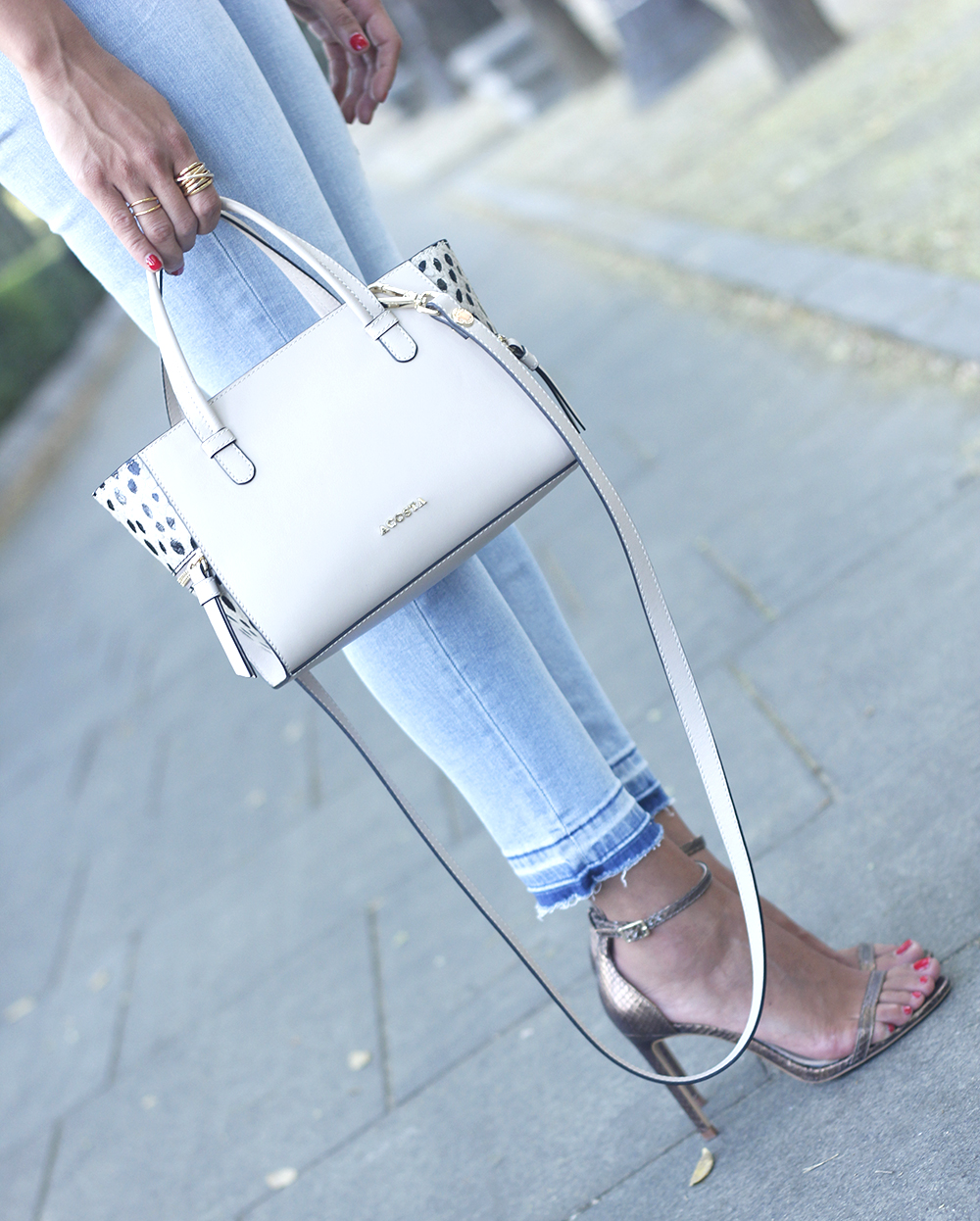 White off the shoulder sweater jeans acosta bag heels outfit style17