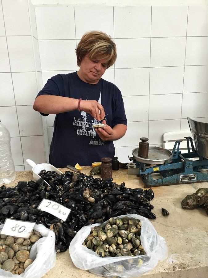 Sampling Oyster in Split Croatia's Fish Market