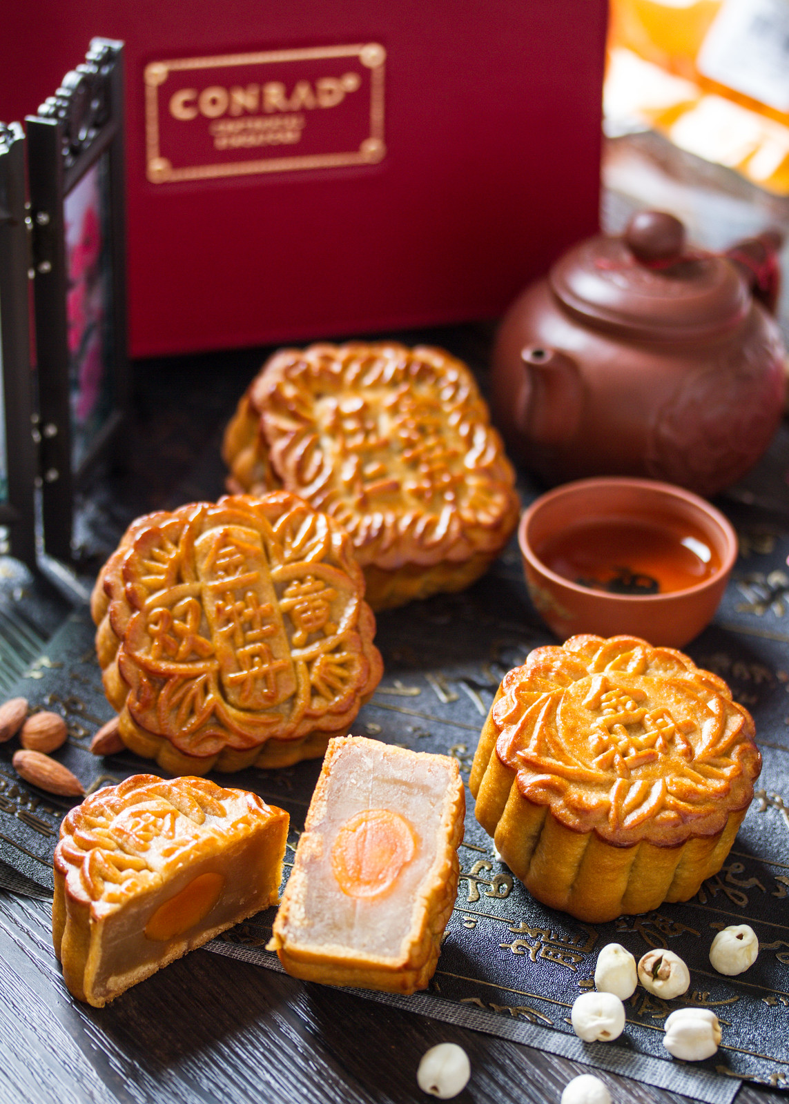 Conrad Centennial Singapore Mooncakes: Golden Peony's Traditional Baked with White Lotus Paste Mooncake and Traditional Baked with Mixed Nuts Mooncake