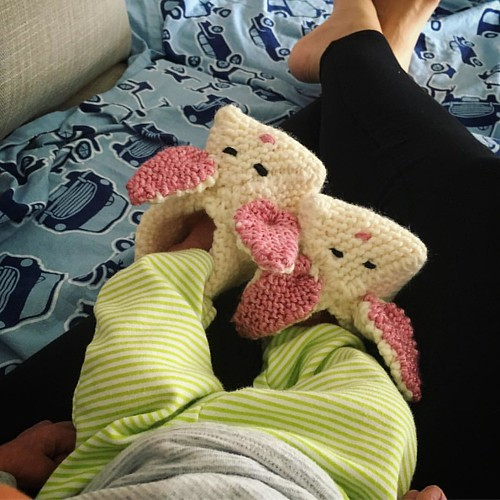 One of us has handknit bunny slippers, the other is a little envious. Thanks @mamason60 ! #motherhood #knitting #bunnyslippers #newborn #littlefeet #warmfeet #madewithlove