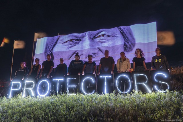 people holding protector sign at Standing Rock