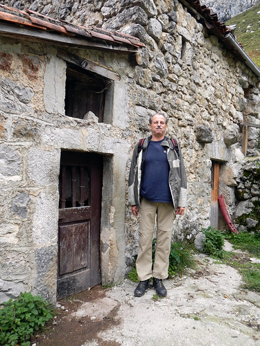 Al demonstrating the height of the doors in the village of Bulnes in Spain