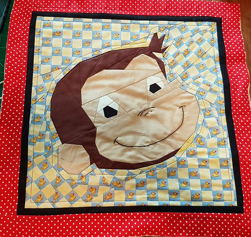 Curious George paper pieced block. Pattern on fandominstitches.com