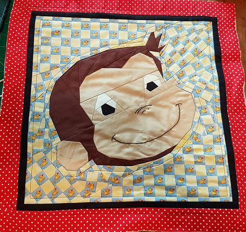 Curious George paper pieced block. Pattern on fandominstitches.com