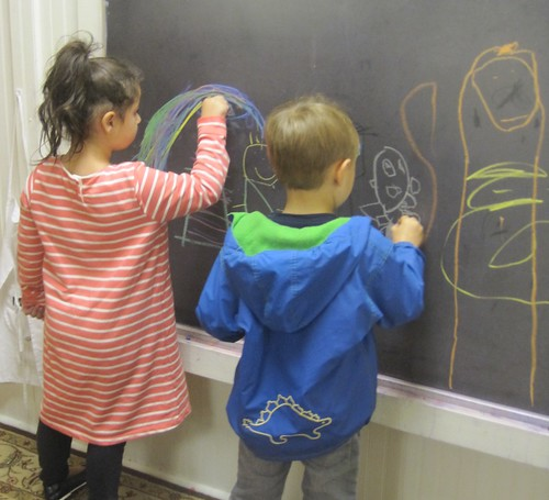 artists at the chalkboard