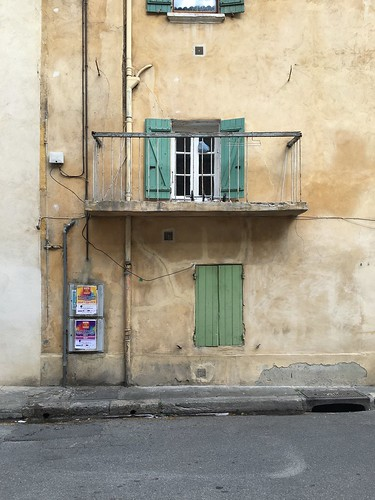 Building with shutters in Avignon